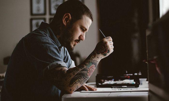 bali tattoo artist sketching